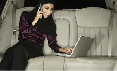 Middle Eastern businesswoman working in limousine
